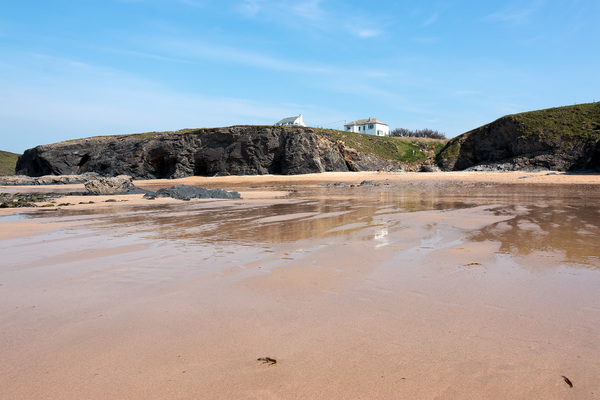 Beach at low tide: Rocky coastline and caves at low tide in Cornwall, England.