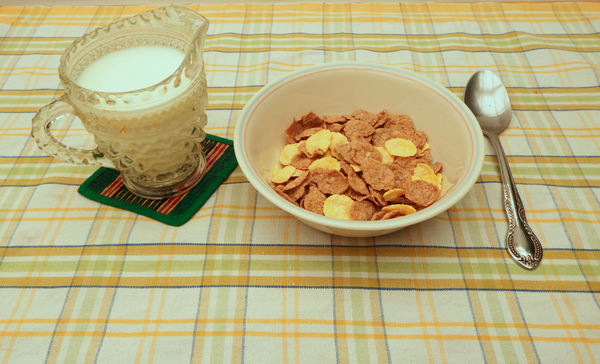 cereal breakfast6: bowl of Western breakfast cereals with jug of milk - mixed grain flakes