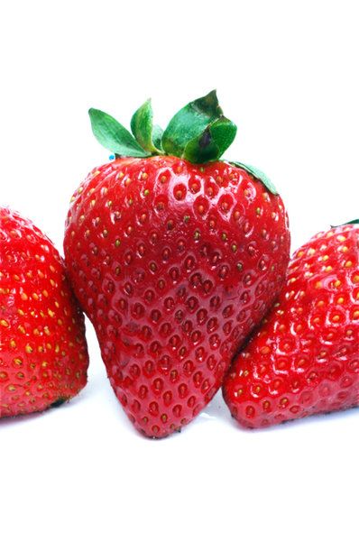 A catched strawberry.: This one was catched between two others...