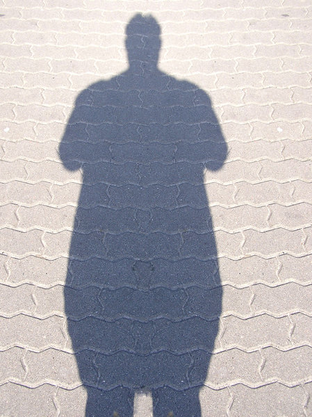 Fat Shadow man: A shadow of a man on the pavement.Please comment this shot or mail me if you found it useful. Just to let me know!I would be extremely happy to see the final work even if you think it is nothing special! For me it is (and for my portfolio)!