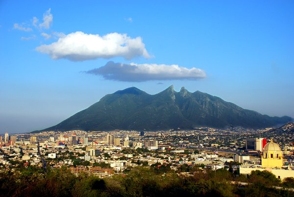Monterrey metro area 1: Monterrey, México, with the symbol of the city, the Cerro de la Silla (Horse chair mountain). Monterrey, Mexico . Skyline of the city.