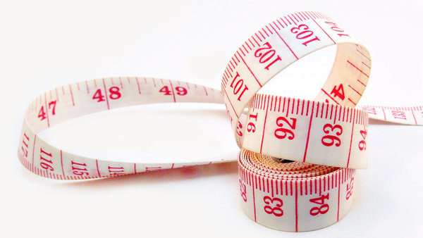 Measuring tape: Measuring tape against white background