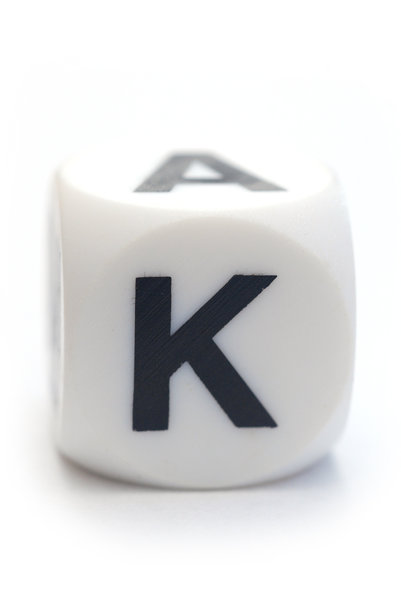 Character K on the cube: Dice with letter