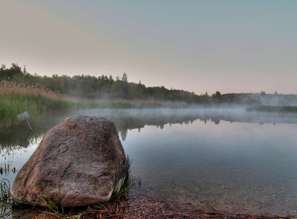 Morning mist - HDR: Before sunrise. A small lake with mist. The picture is HDR