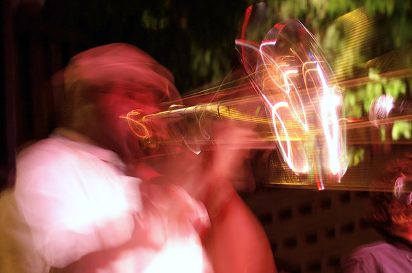 Horn Player: Impressionistic photo of a horn player at a club in Austin, Texas.