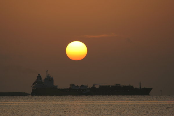Sunrise with a Ship