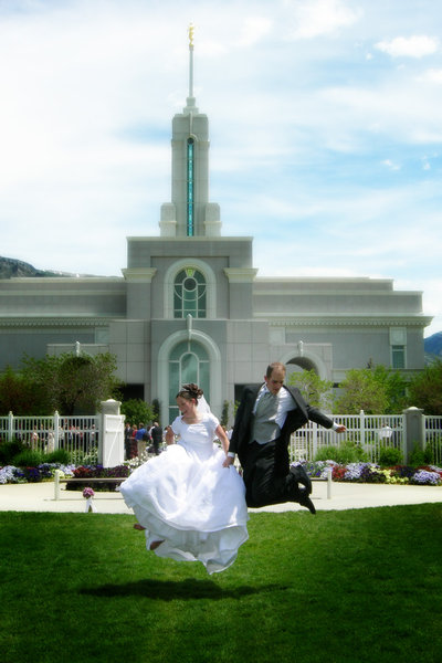 Excited newlyweds: Two newlyweds jumping in the air