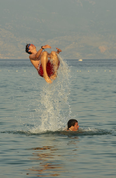 Young boys jumping in the sea