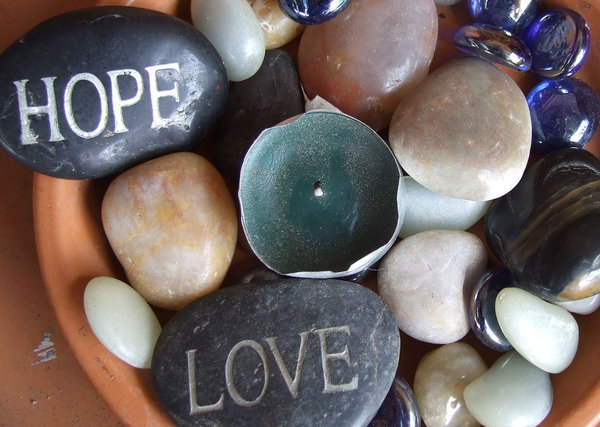 hopeful love in rocky situatio: rocks - pebbles with hope and love inscribed
