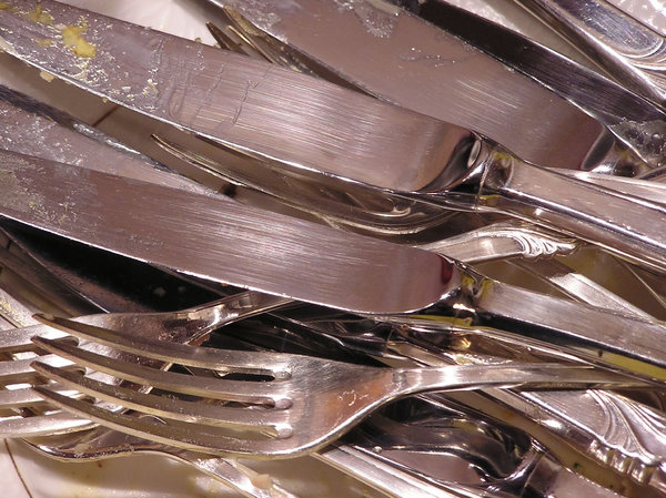 Dirty cutlery: In the sink.