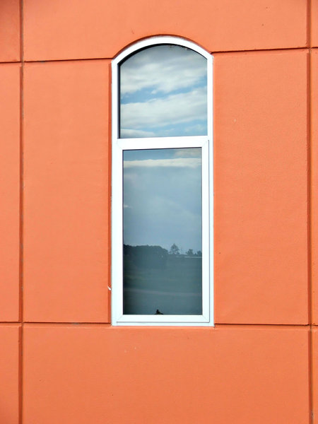 angles, perspectives, reflecti: windows in orange walls showing angles, perspectives and reflections