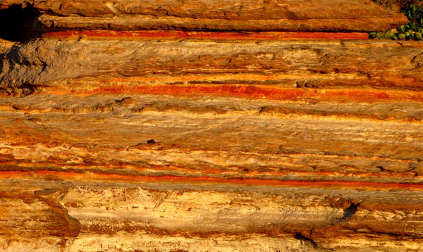 layered rocks: appearances, shapes, layers and colours of a variety of beach-side rock-faces