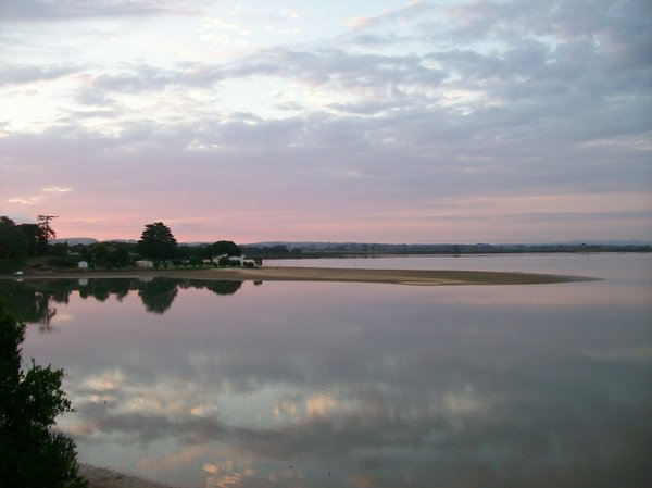 Calm Waters, the Sandspit: Sunset over a Manukau Harbour sandspit, the clouds are reflected in the calm harbour waters