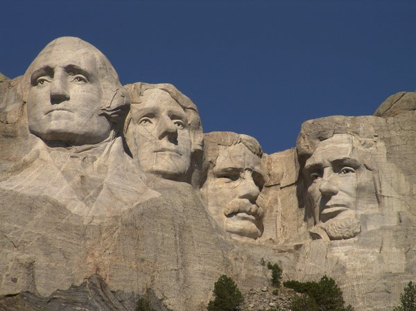 Mount Rushmore - South Dakota: Close up of Mount Rushmore and the faces carved into granite of Presidents Washington, Jefferson, Roosevelt and Lincoln located in South Dakota.