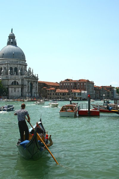 Venice boats: A gondola and other boats in Venice.