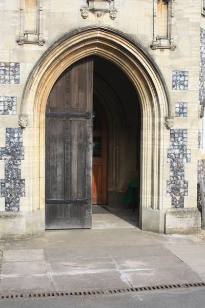 Church door: Half-open door to a church