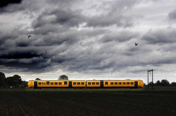 Dutch train: Dutch train under stormy sky