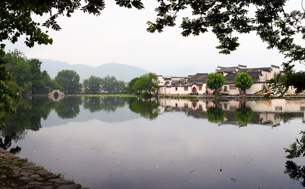 Chinese Idyll: This is a view at Hongcun village, province Anhoi, China. The village is built in according with Feng Shui rules. The pano is stitched of 4 shots in portrait orientation (1 row, 4 columns).Any comments and ratings are welcome.