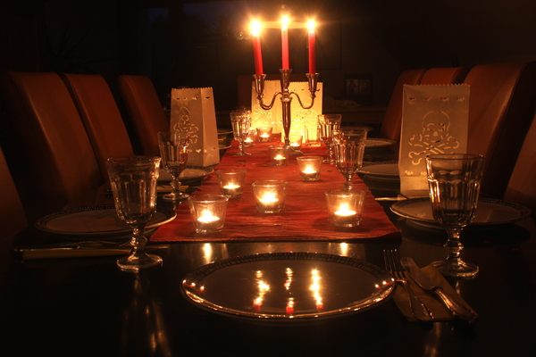 Halloween diner: Laid table with candles and halloween decoration.