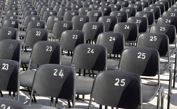 Chairs: Numbered chairs at an open-air amphitheatre in Israel.
