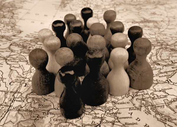 together-old europe: game pieces on world map symbolizing togetherness - mixed community