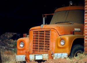Abandoned Truck: Orange, old and abandoned  truck
