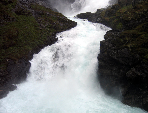 waterfall in norway: The mighty Kjosfossen waterfall cascades down the mountainside in Norway.