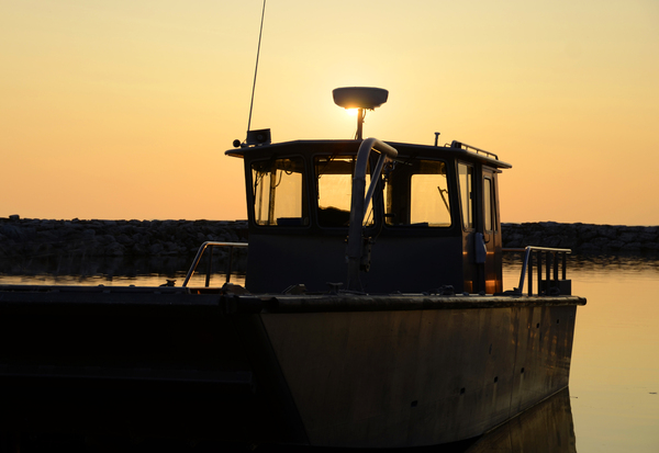 Working Boat at Sunset: A work boat in Leland, MI at sunset
