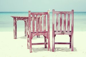 Beach chairs: Summer on tropical island (Aruba). Chairs and table on the beach with sea view.