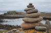 Rock sculptures: Pile of stones on a rocky beach