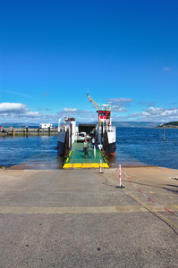 Car ferry loading: Loading ramp and vehicles loading onto a car ferry - CalMac, Largs, Scotland