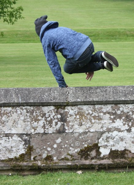 The getaway?: Teen boy leaping a wall