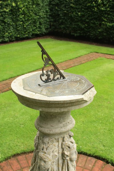 Sundial: Sundial in a sheltered garden