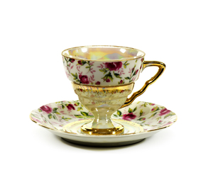 Tea Cup and Saucer: Elegant hand painted China with gold trim and pearl paint inside the cup and on the stem