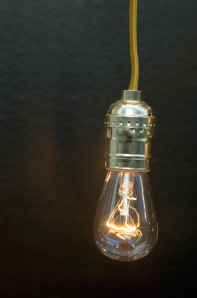 Light bulb: Clear light bulb on a red wire.