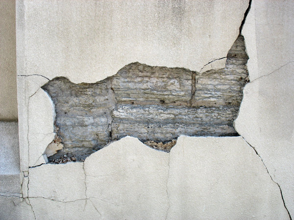 damaged facade: a damaged wall facade.