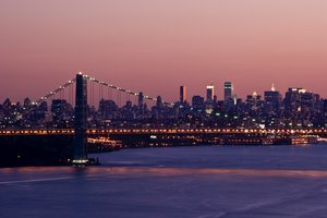 Manhattan at Sunset: George Washington Bridge and Manhattan Skyline during the golden hours from Palisades.