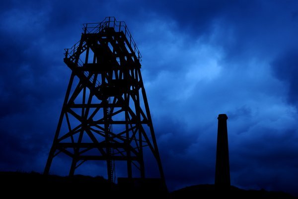 old mine buildings: ... against a dramatic blue backdrop.
