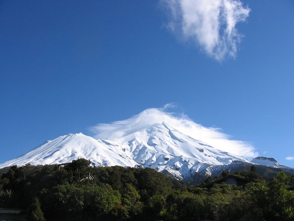 Mountain with mantle: Mount Taranaki (also known as Mount Egmont) on the west coast of the North Island of New Zealand. A mantle of cloud hangs over the summit.