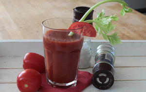 Tomato Juice: Decorated Tomato Juice on a tablet. The most loved drink in airplanes