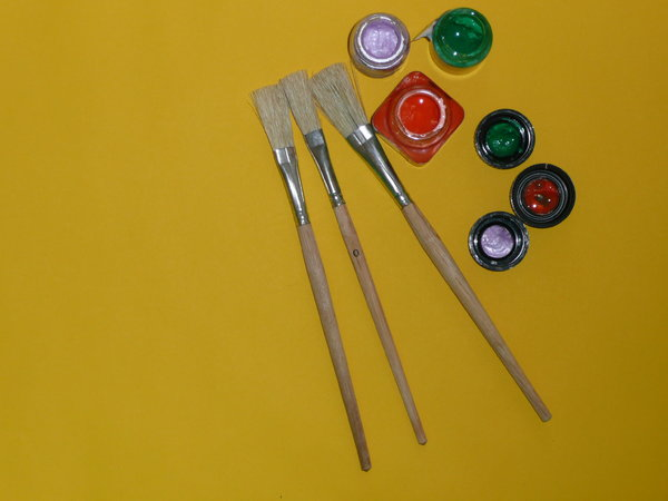 Painting: Paint brushes and paint pots on a sheet of paper