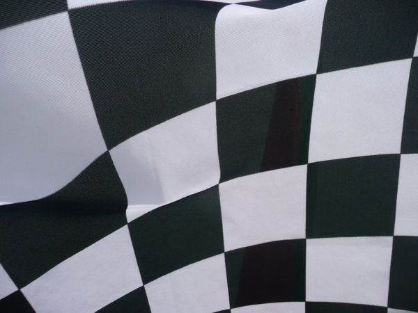 Checkered Flag: Close up of a checkered Flag at a motorbike race.