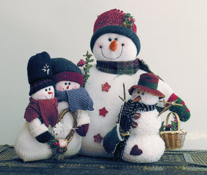 Snow Family: A cuddly group of snowmen.