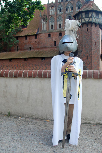 Young teutonic order's knight : 7 year old boy in clothing of teutonic order's knight, castle Malbork (Marienburg), Poland
