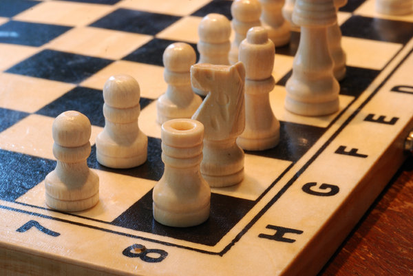 White chess army 3: White pawns and pieces on the  chequer