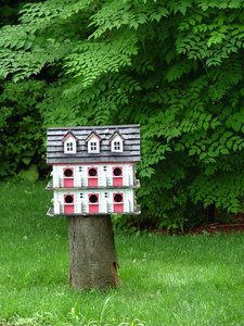 Bird's appartment: Big bird house in a park/garden in July 2010 on a sunny afternoon.
