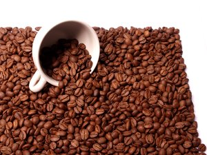 Cup in beans: A coffee cup in coffee beans