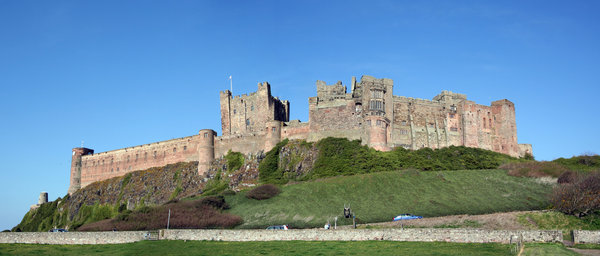 Bamburgh Castle 1: Bamburgh Castle is probably the finest castle in England. It is perched on a basalt outcrop on the very edge of the North Sea at Bamburgh, Northumberland. It commands stunning views of the Farne Islands, Holy Island and land' ward to the Cheviot hills.