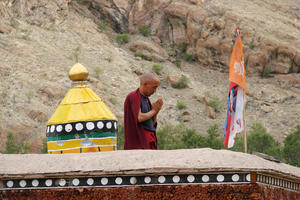Buddhist Monk Praying: A Buddhist Monk Praying at the Hemis Monastery, Ladakh.