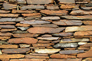 Stone wall: Texture of flat stones and small rocks